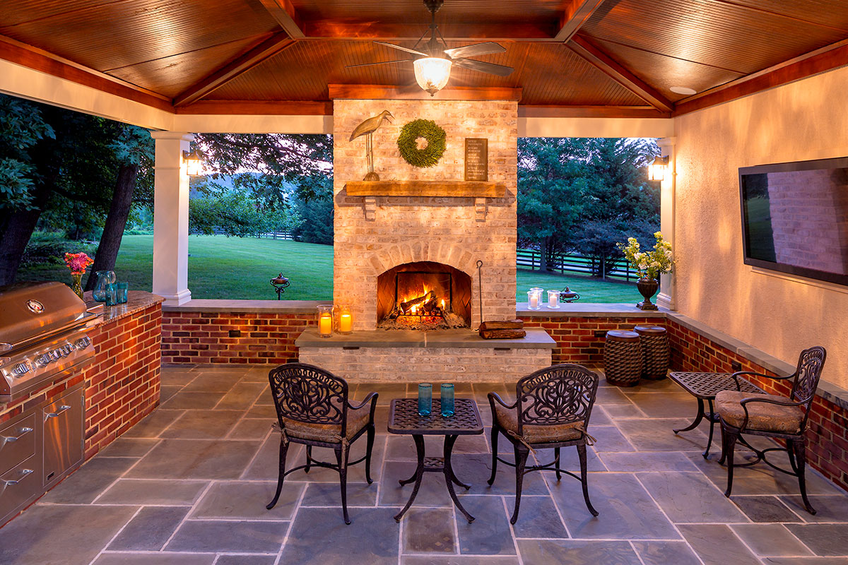 Outdoor Fireplace by Live Green Landscapes